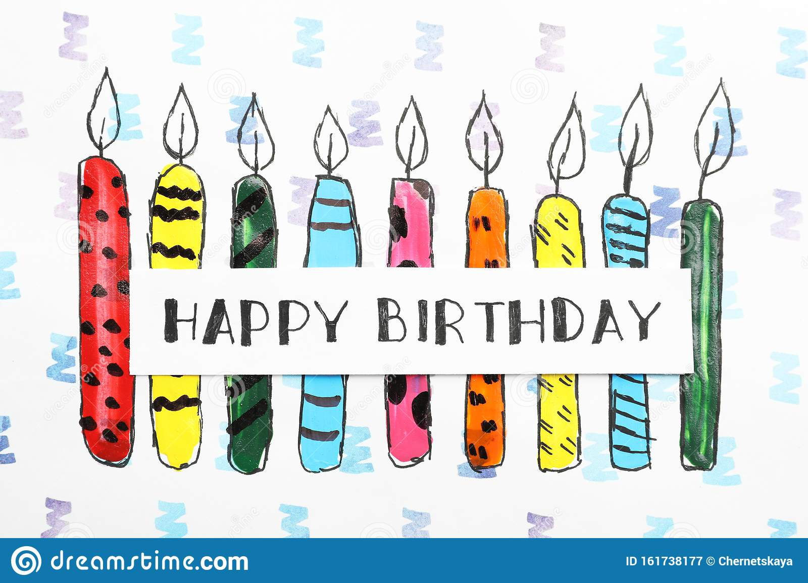 Card with words HAPPY BIRTHDAY and colorful drawn candles on paper sheet