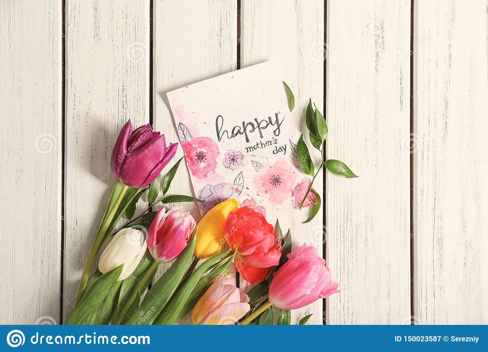 card with words happy mother s day and flowers on wooden