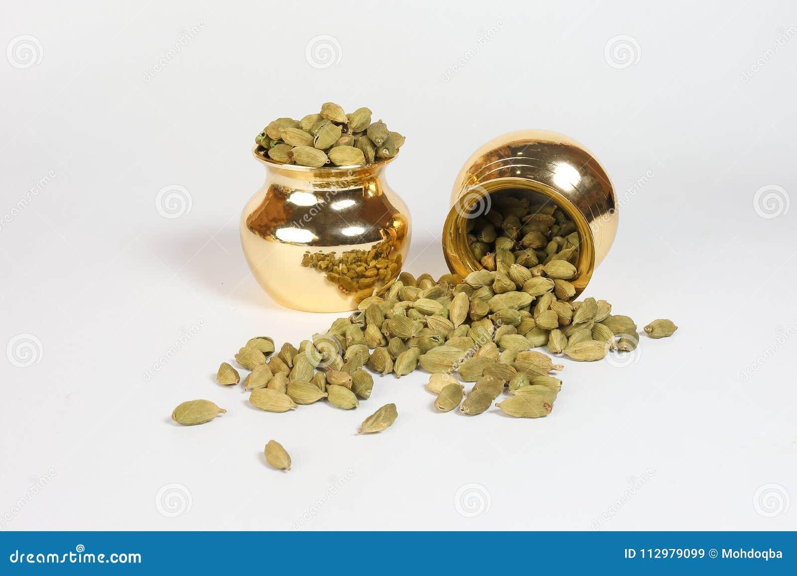 Cardamom spice in shiny metal pot
