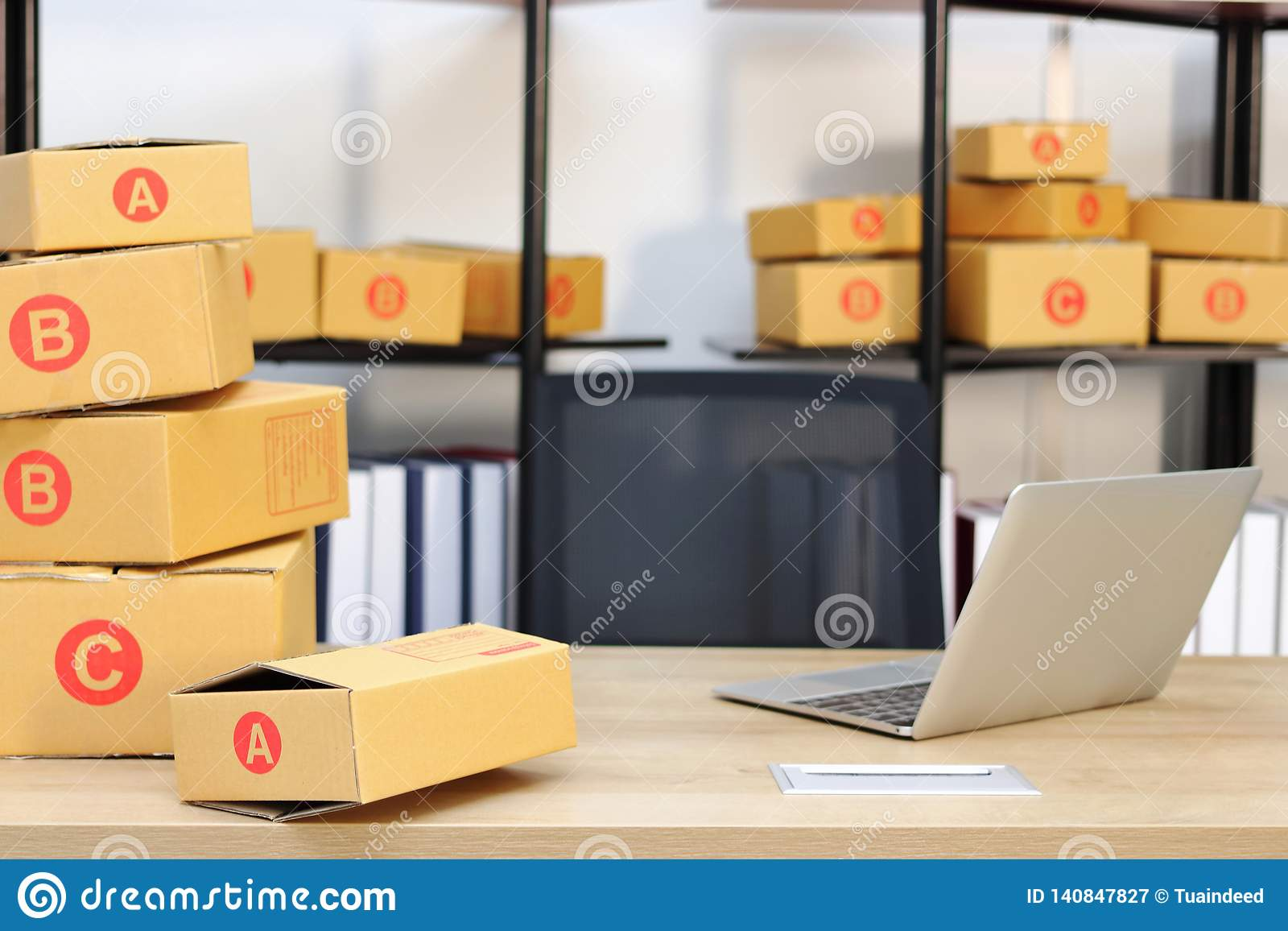 Cardboard box on workplace at home. Start up small business