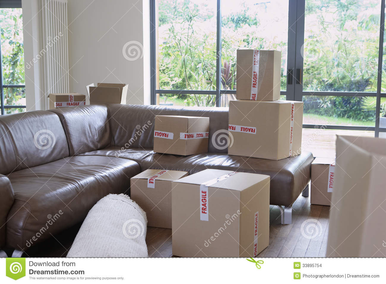 New Living Room Cardboard Boxes In New Living Room Stock Images Image 33895754