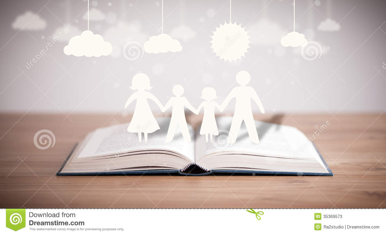 Cardboard Figures Of The Family On Opened Book Stock Image Image