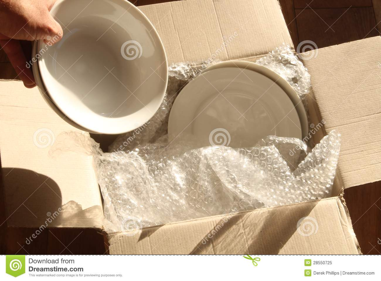 Cardboard Packing Box Plates And Bubble Wrap Stock Image