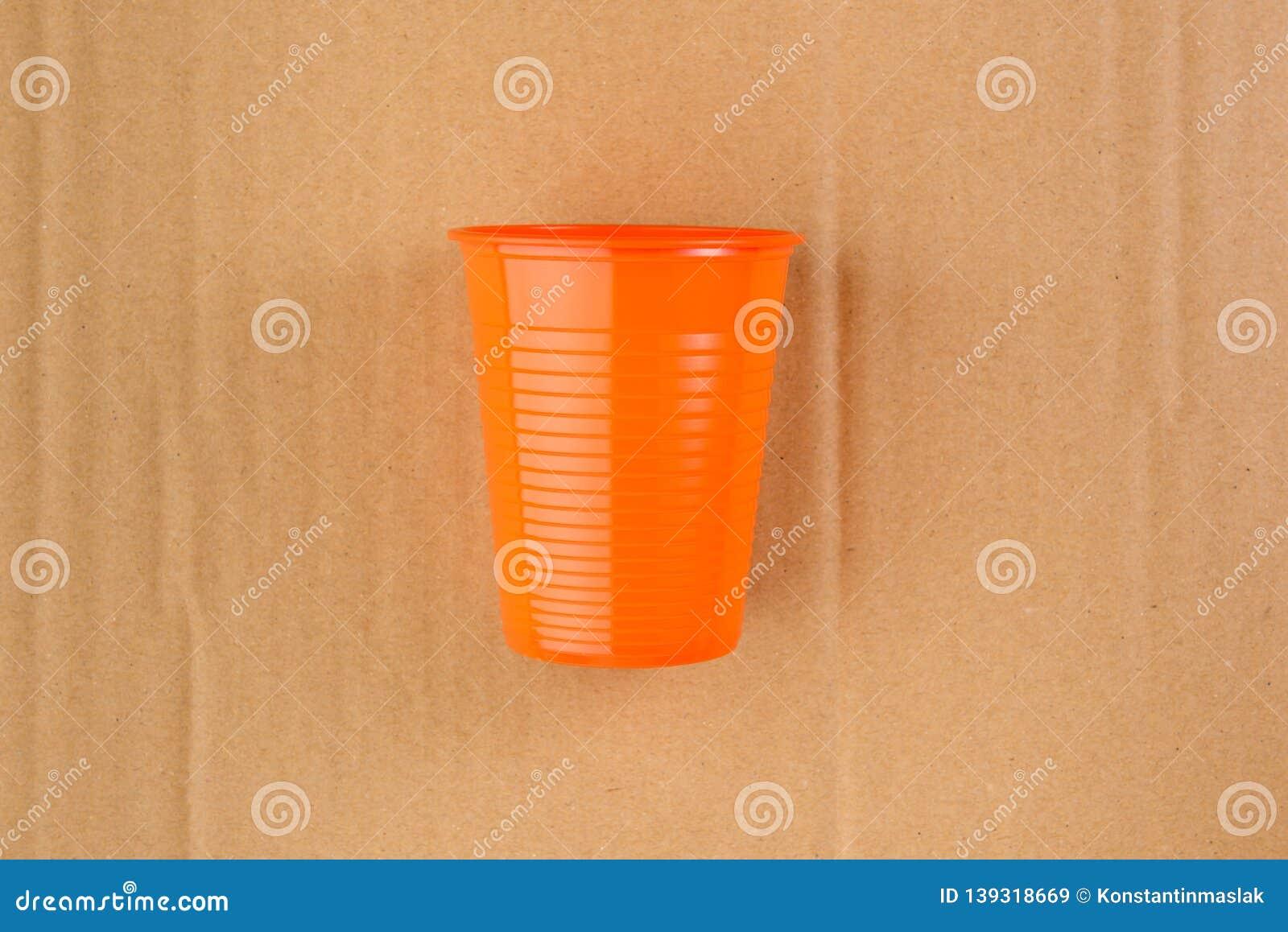 Empty orange plastic cup
