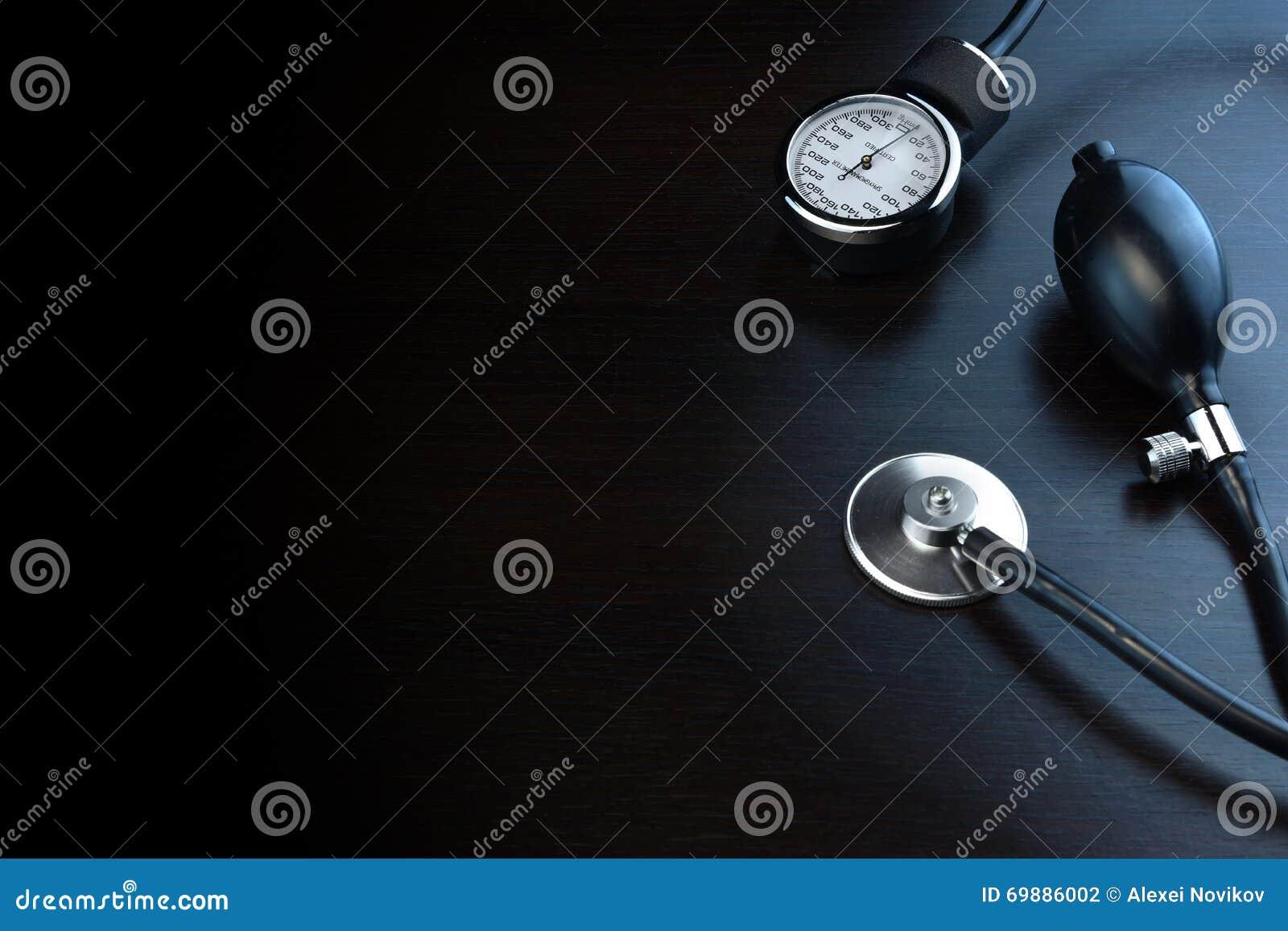 Cardiology Medical Equipment On Black Wooden Background In Back