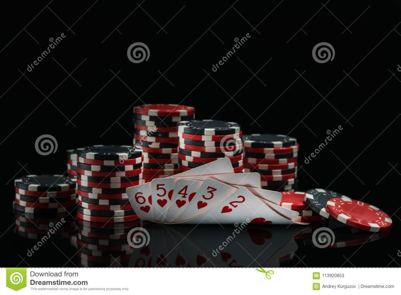 Cards with a win and poker chips in the dark on a black background