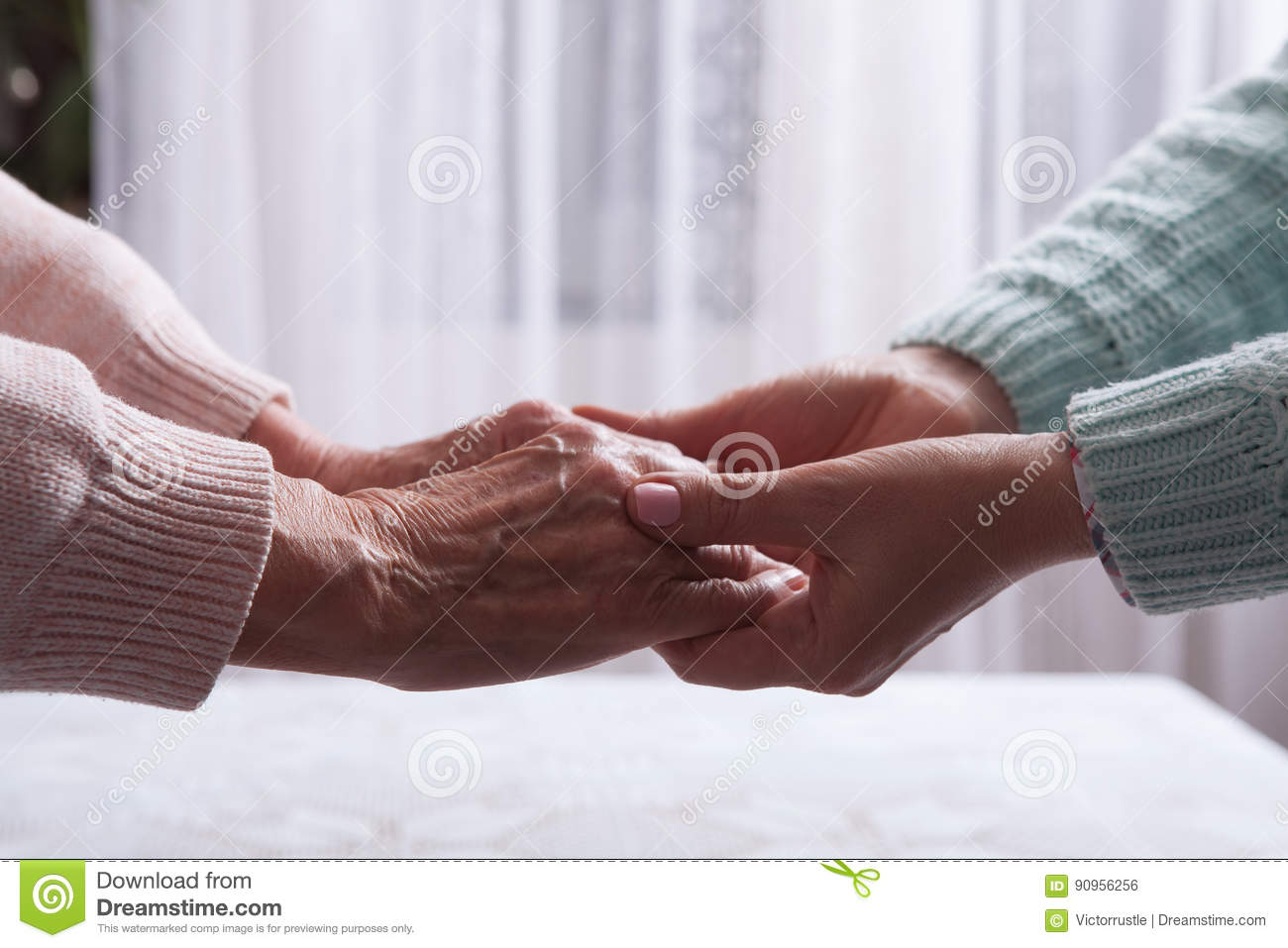 Care is at home of elderly. Senior woman with their caregiver at home. Concept of health care for elderly old people