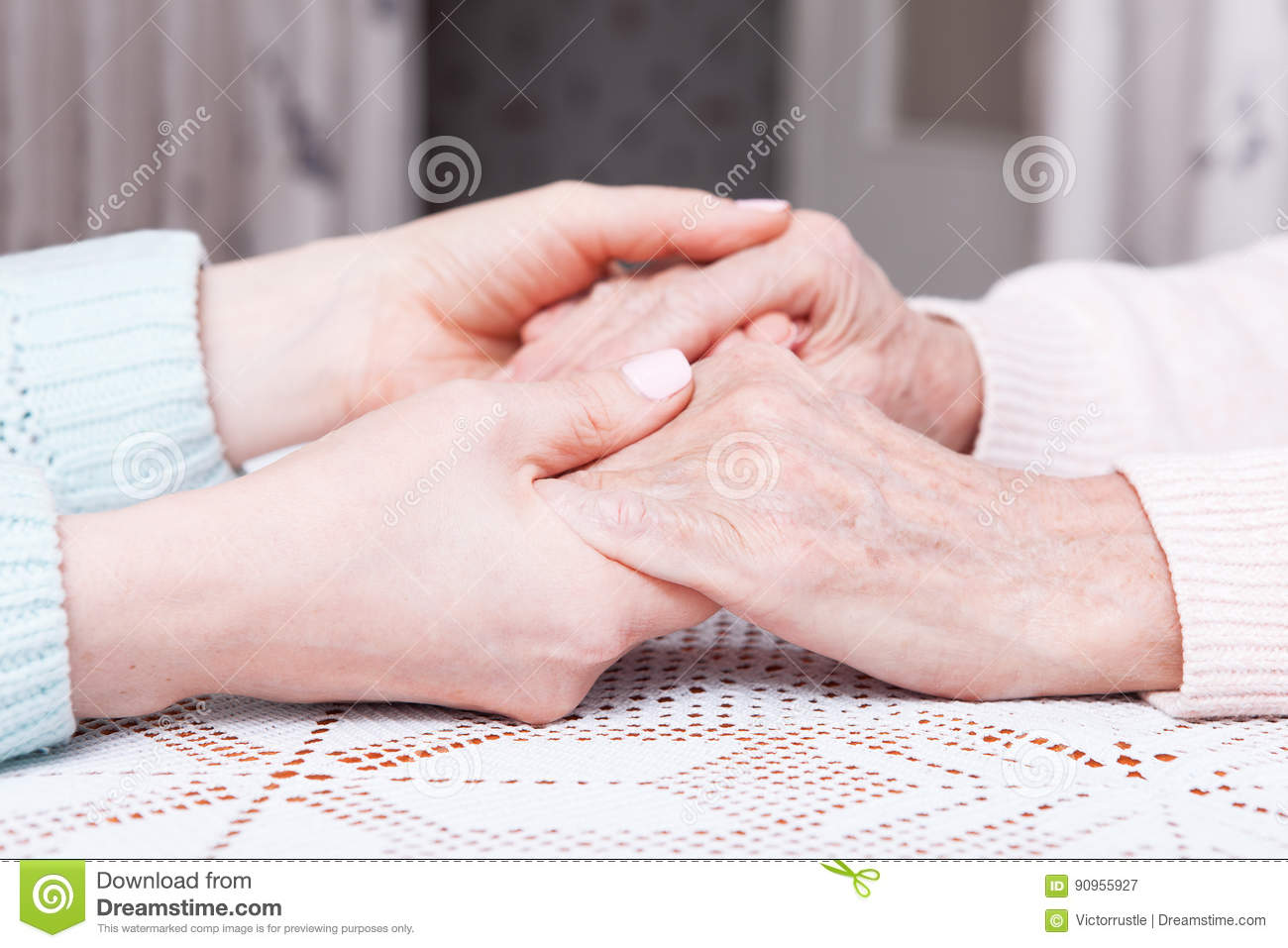 Care is at home of elderly. Space for text. Senior woman with their caregiver at home. Concept of health care for