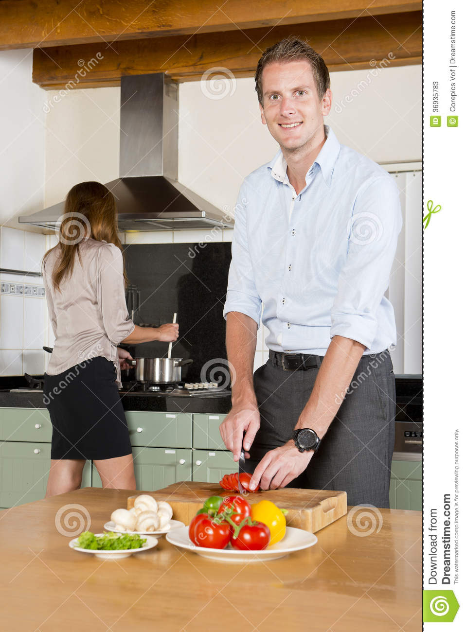 Career couple in kitchen