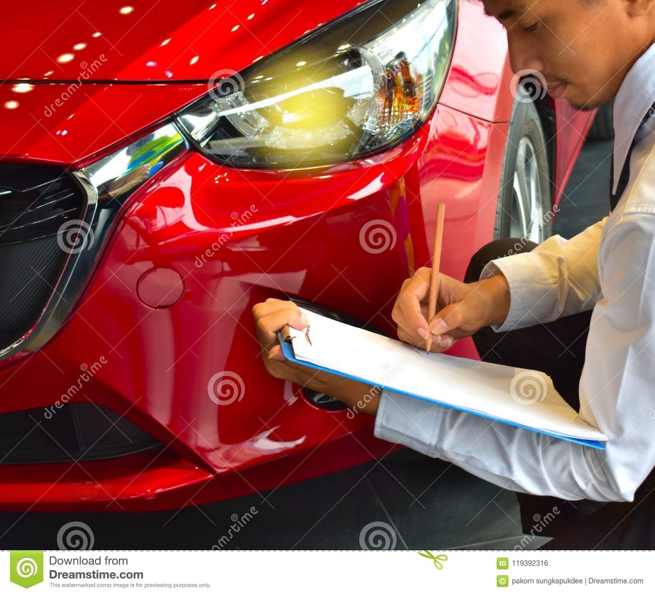 career man saleman business inspection writing on notepad or book, paper with car blurry background.for transport automobile autom