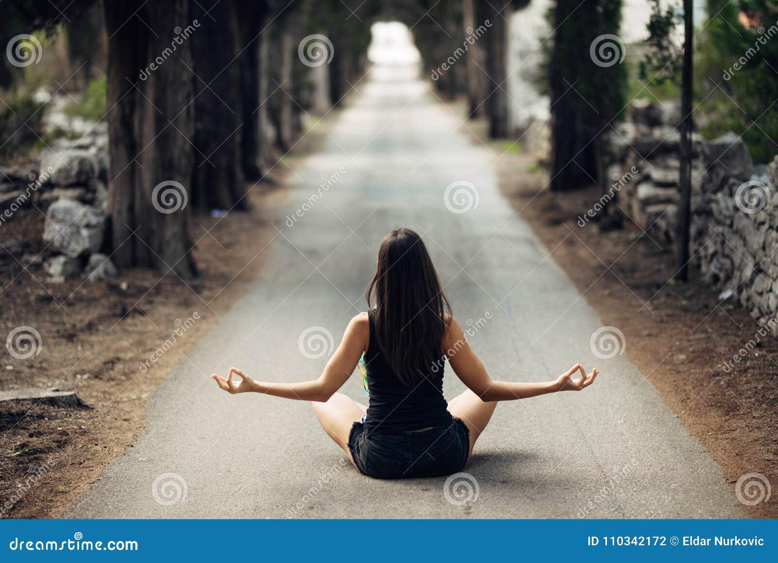 Carefree calm woman meditating in nature.Finding inner peace.Yoga practice.Spiritual healing lifestyle.Enjoying peace,anti-stress