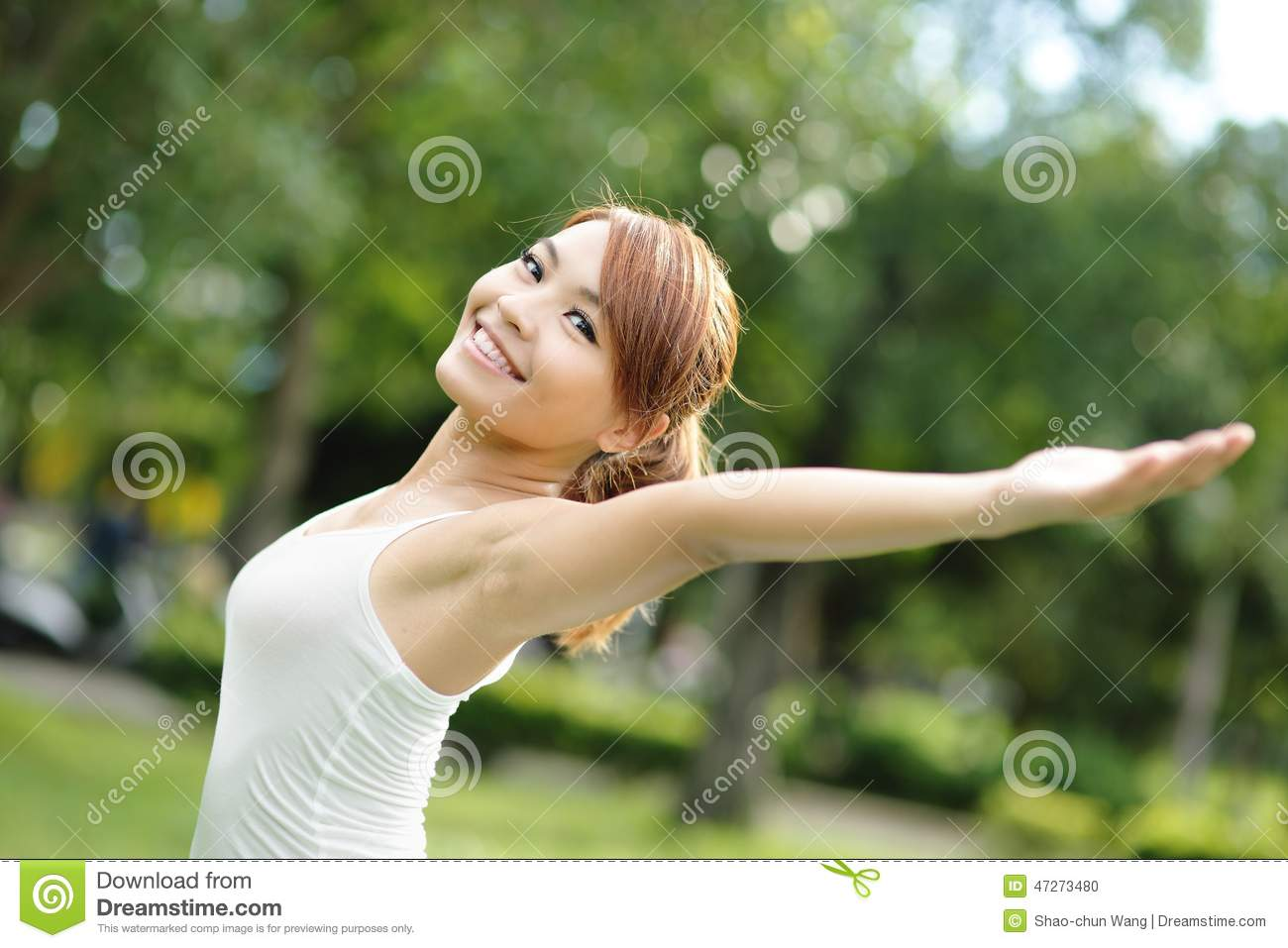 3e150792c9b Carefree and free cheering woman in the park. girl raising her arms up  smiling happy. asian beauty