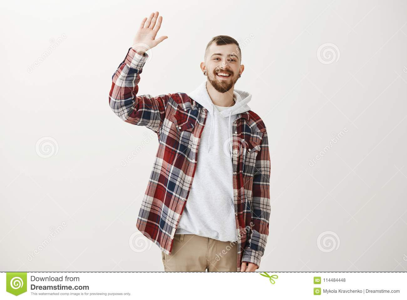 Carefree friendly male student in stylish clothes raising palm to download carefree friendly male student in stylish clothes raising palm to give high five m4hsunfo