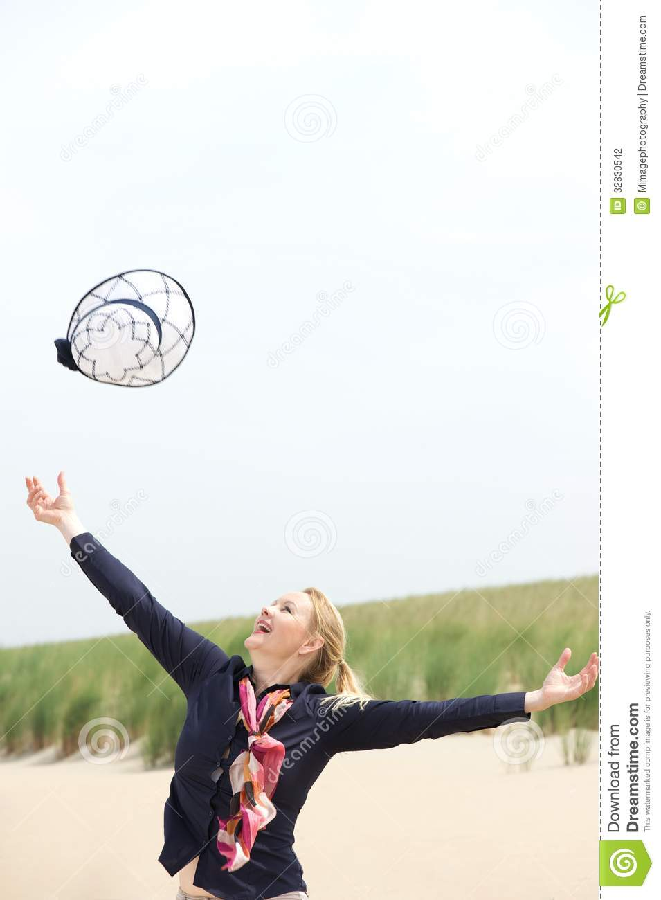 Carefree Older Woman Throwing Hat Up With Outstretched ...