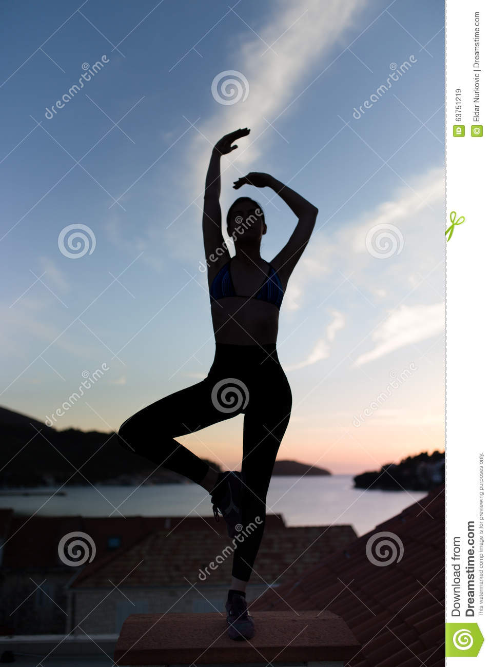 Carefree woman dancing in the sunset on the beach.Vacation vitality healthy living concept