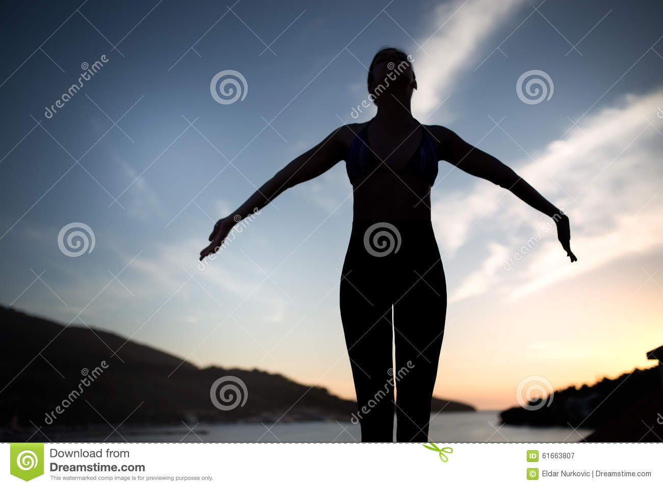 Carefree woman dancing in the sunset on the beach. Vacation vitality healthy living concept. Free woman enjoying freedom feeling h