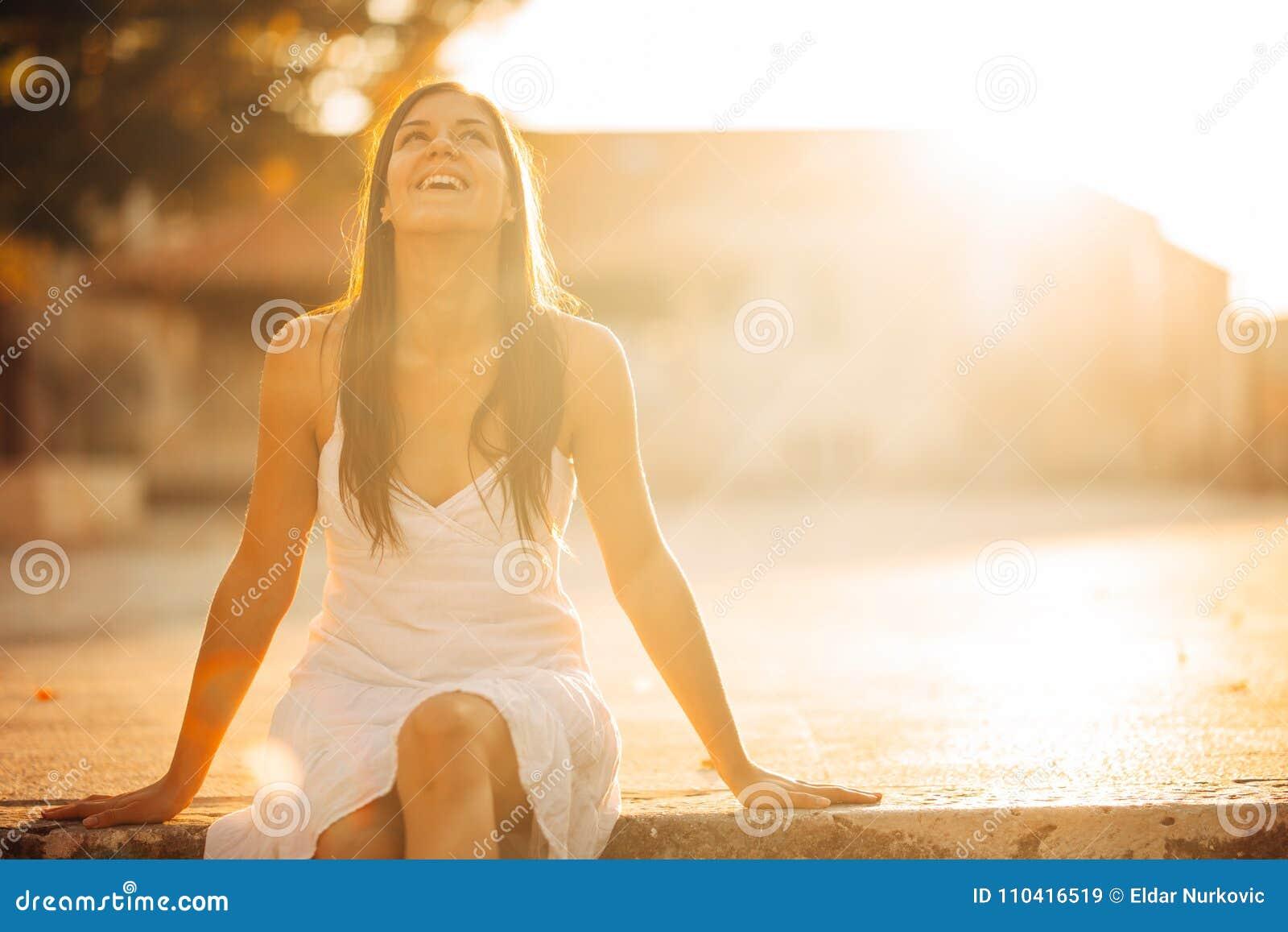 Carefree woman enjoying in nature,beautiful red sunset sunshine.Finding inner peace.Spiritual healing lifestyle.Enjoying peace,ant