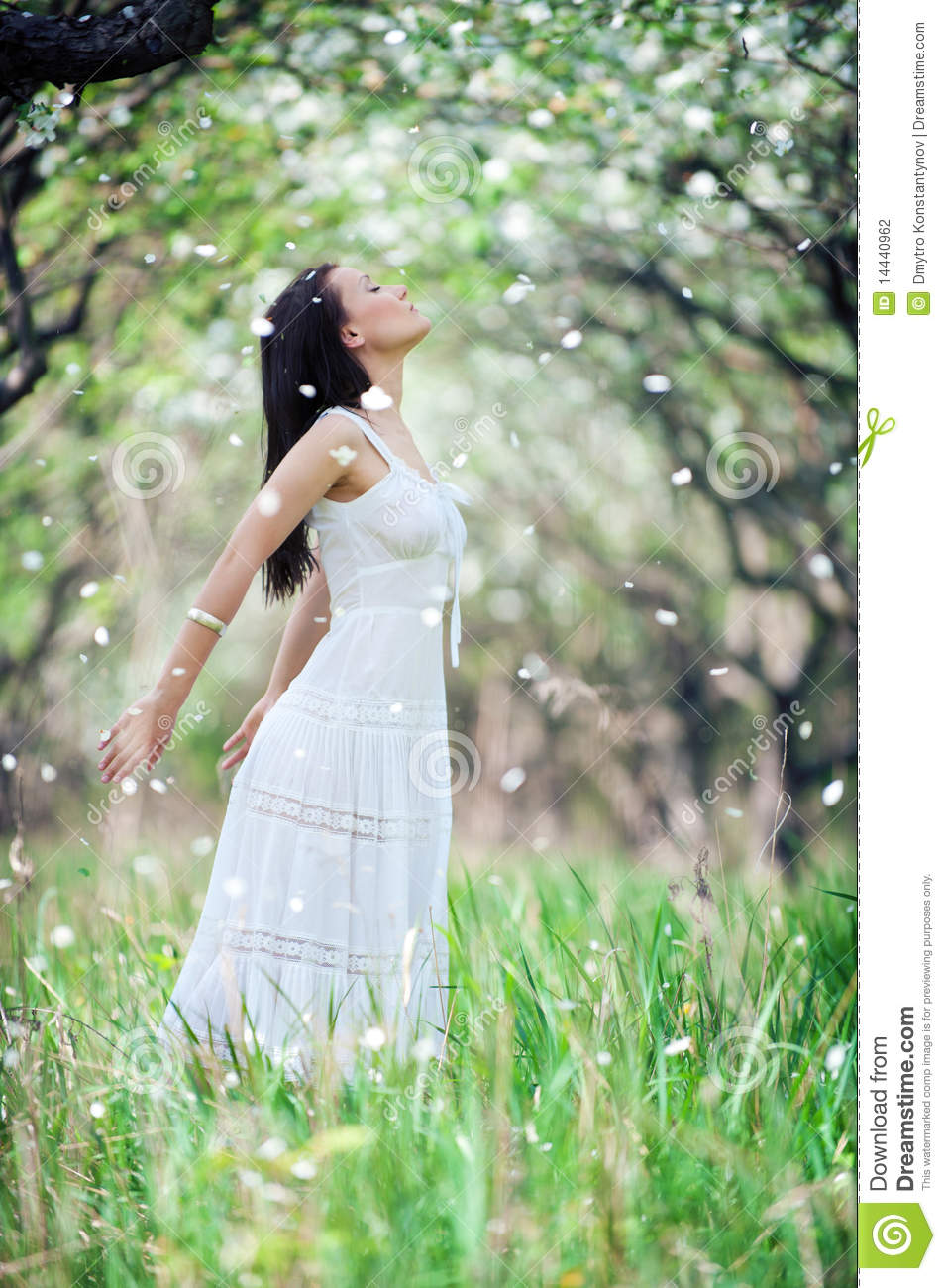 Carefree young woman in white dress