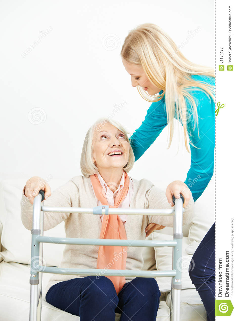 Caregiver Helping Old Woman Getting Up Stock Photo Image