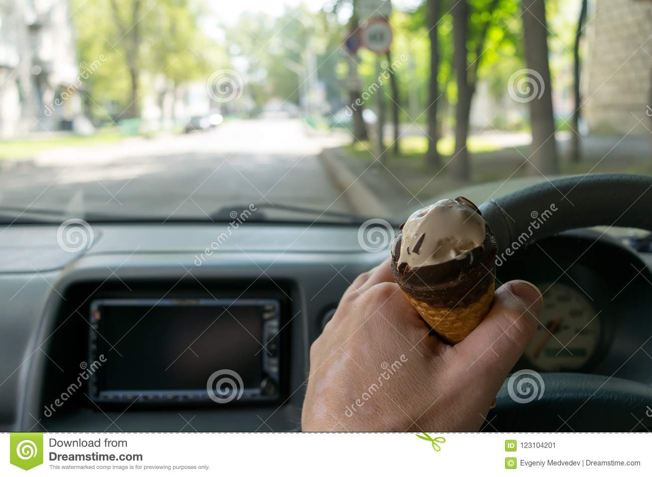 driver keeps ice cream behind the wheel of the car stock image