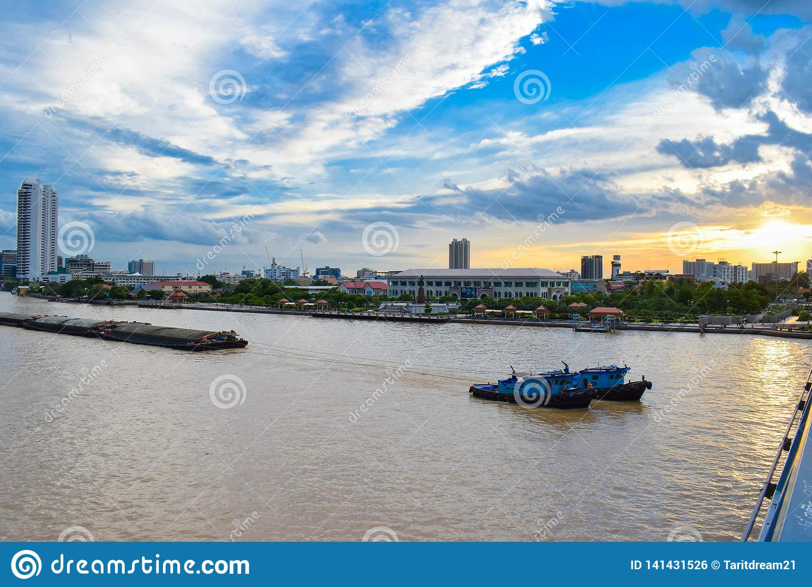 The cargo ship is one of the things seen in the Chao Phraya River that is adjacent to the capital, Bangkok