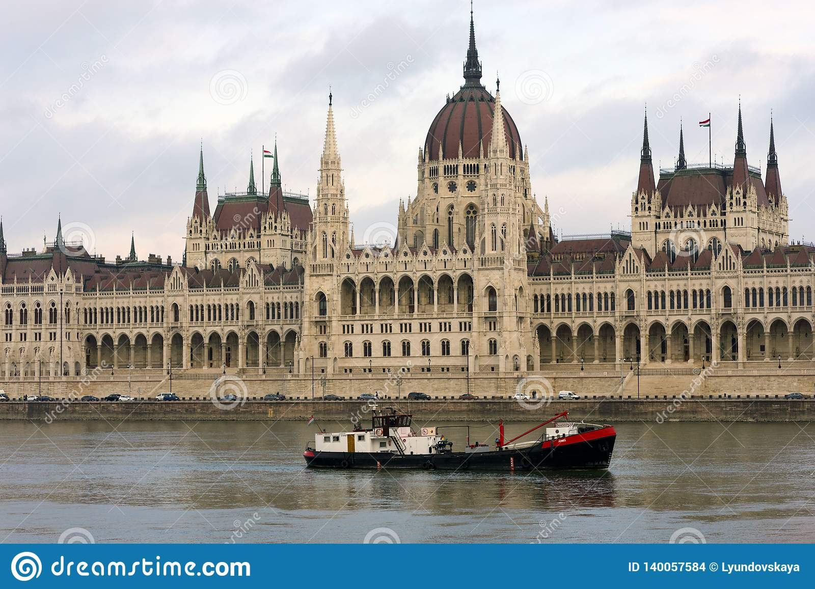 Barge on the background of the Parliament, famous sights of Budapest on a cloudy day
