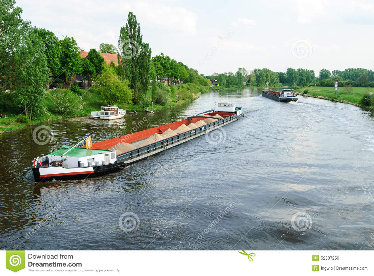 Cargo ships on a river