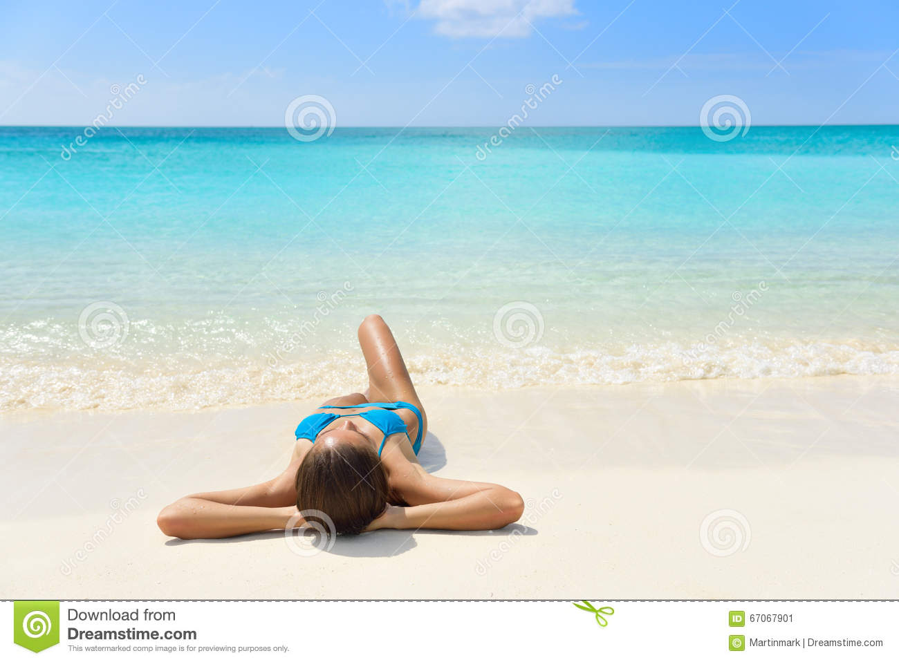 Caribbean beach vacation - suntan relaxation woman