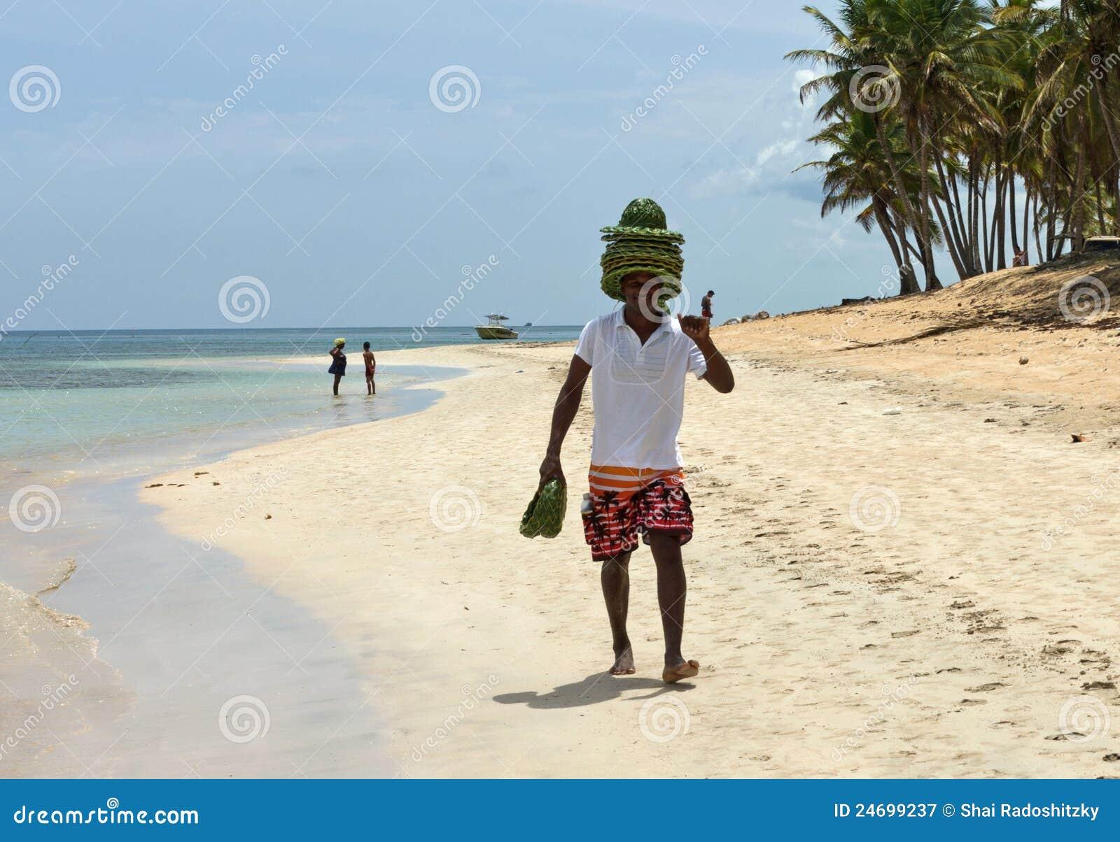 Caribbean Beautiful Ocean And Hat Seller Editorial