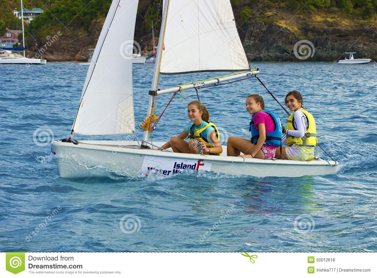 Caribbean Fun: Young Girls In A Sailing Boat Editorial