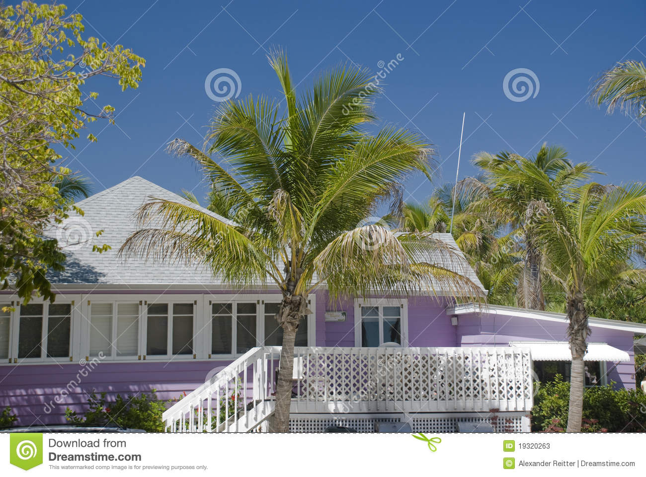 typical caribbean style house made of wood and painted purple