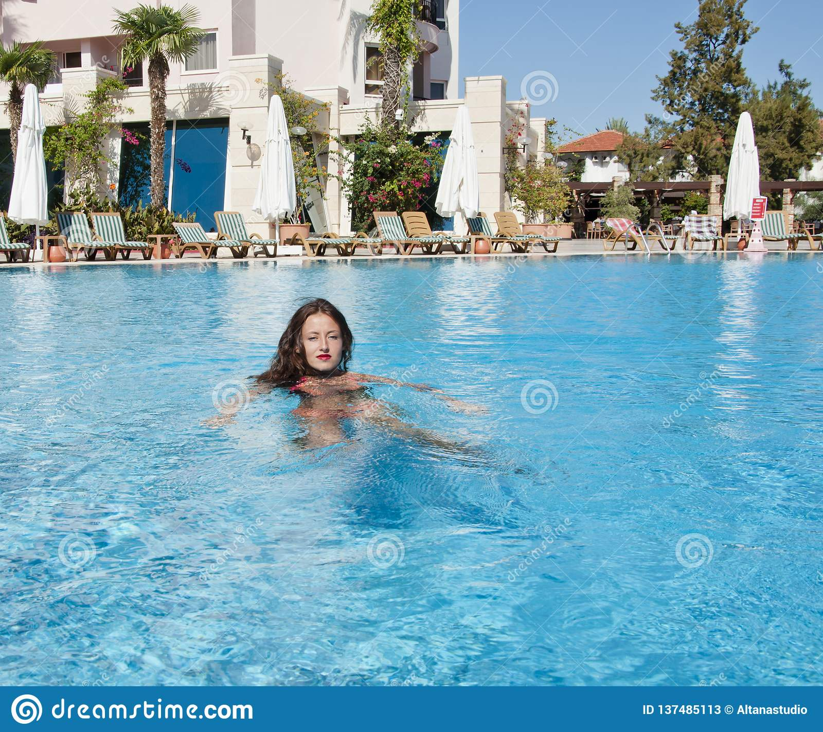 Caribbean sea. Dope. Spa in pool. Miami beach is sunny. Swag. girl with red lips and wet hair. woman in swimming pool.