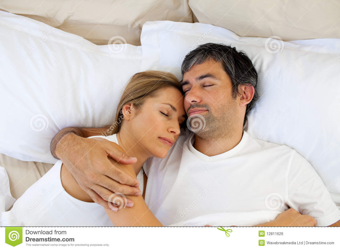 caring lovers sleeping lying on the bed royalty free stock