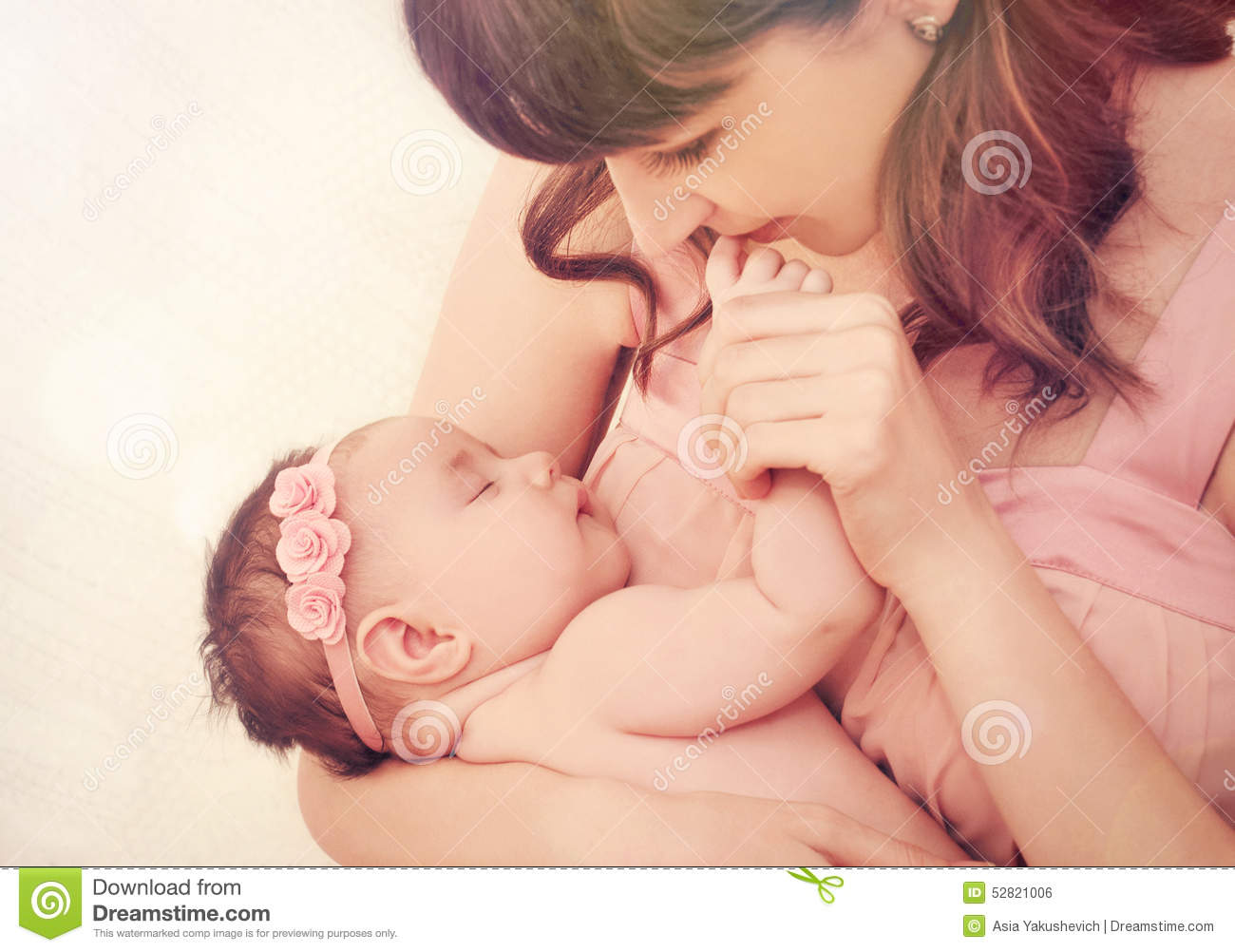 Caring Mother Kissing Fingers Of Her Cute Sleeping Baby -1117