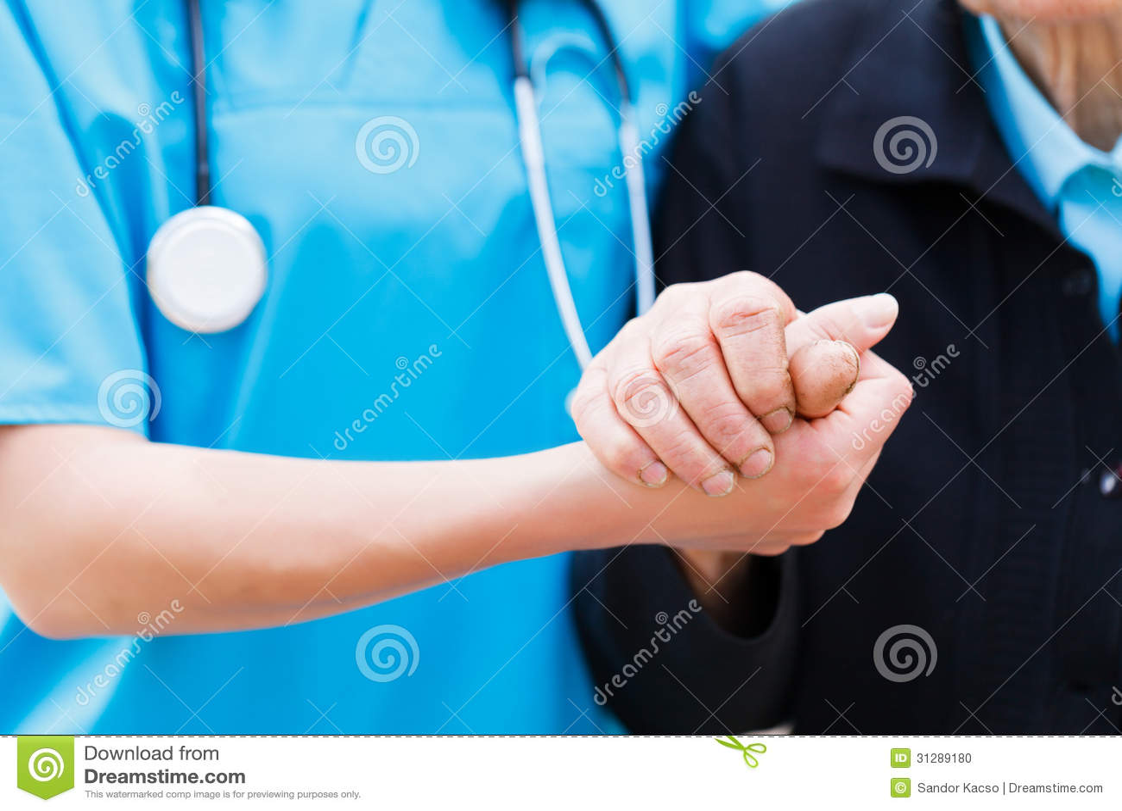 Caring Nurse holding Elderly Hands