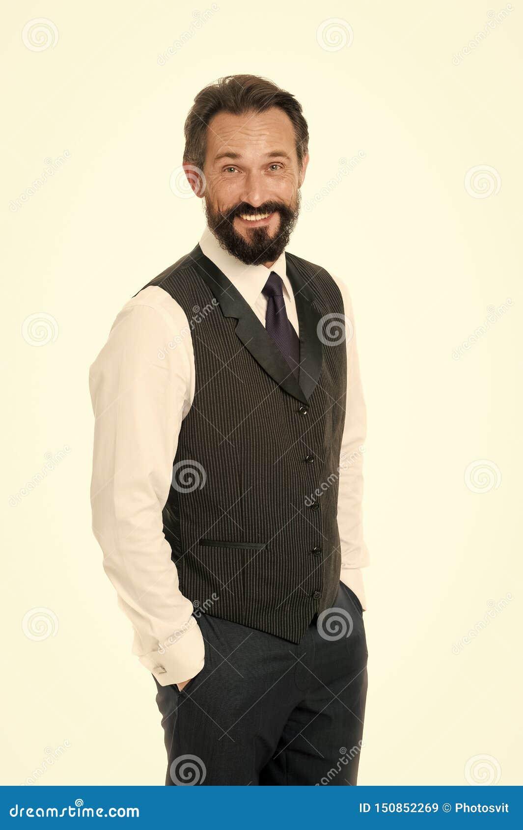 Carisma como llave al ?xito Cara alegre del hombre de negocios Manos formales cl?sicas del control del traje del hombre de negoci