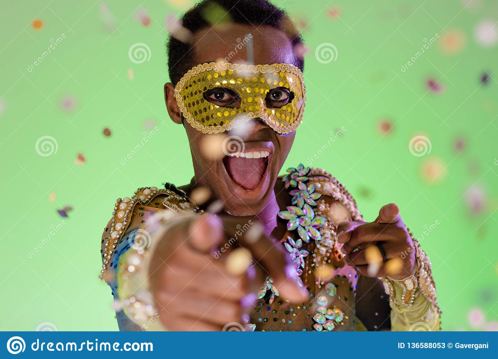 Carnaval Brazil. Throwing confetti. Colorful background. Carnival concept, funny and party. Portrait of brazilian guy dressed up