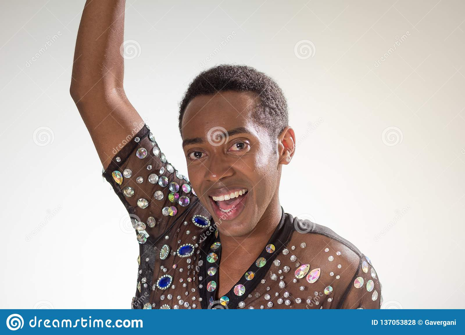 Carnaval Brazil. Face of african american man wearing costume. Bright background. Party concept, celebration and festival
