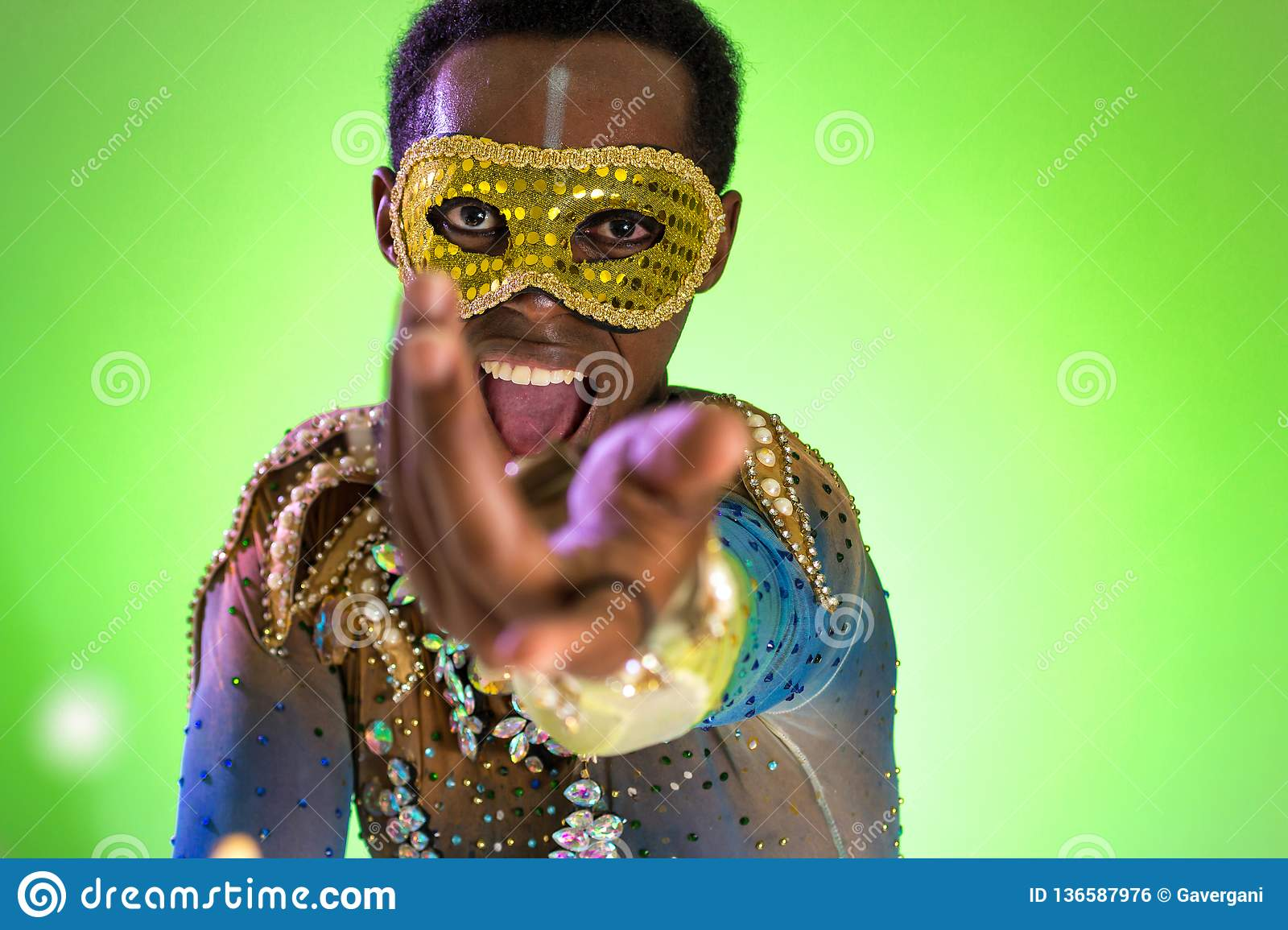 Carnaval Brazil. Face of african american man wearing costume. Bright and Colorful. Holiday concept, tradition and costume