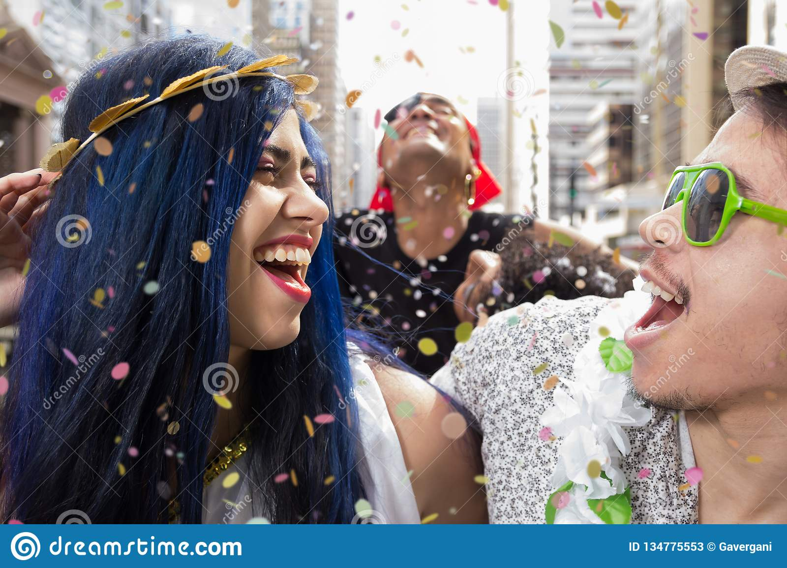 Carnaval party. Dressed group of Brazil friends going to street Carnival. Happy brazilian partygoers in costume in parade festival