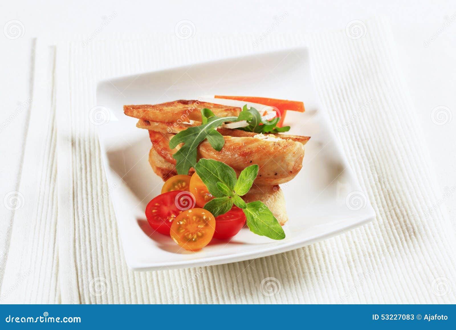 Carne del pollo y pan curruscante
