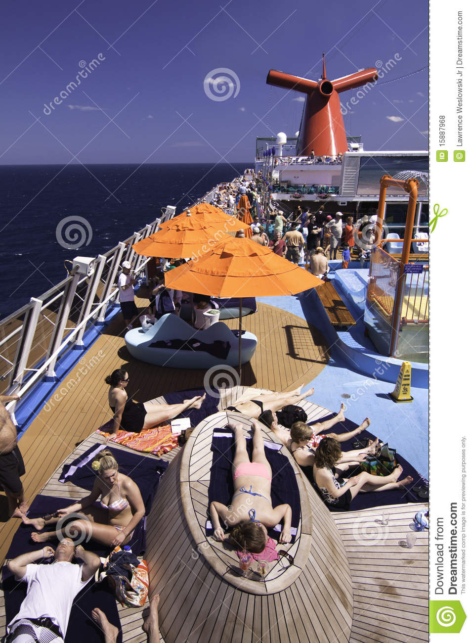 Carnival cruise ship sunning on deck editorial stock for Balcony on cruise ship