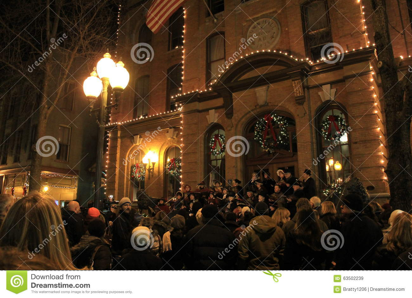 Carolers and bystanders enjoying the night, Victorian Street Walk,Saratoga,New York,2015