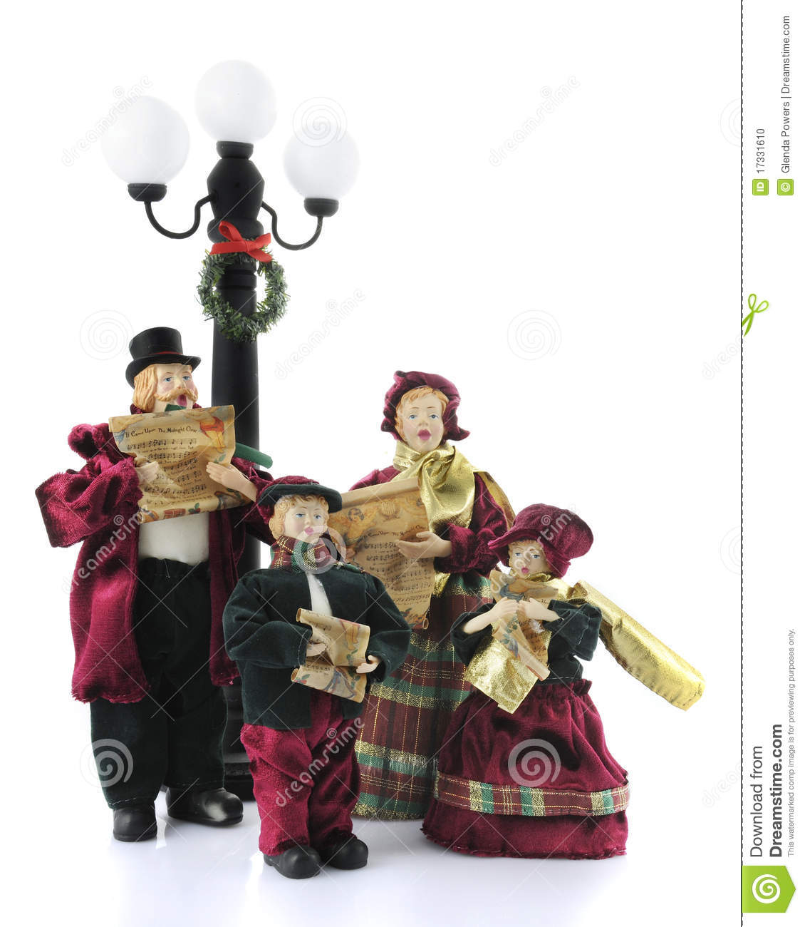 Christmas Caroling Family Set Of 4: Caroling Figurines Stock Photo. Image Of Wreath, Parchment