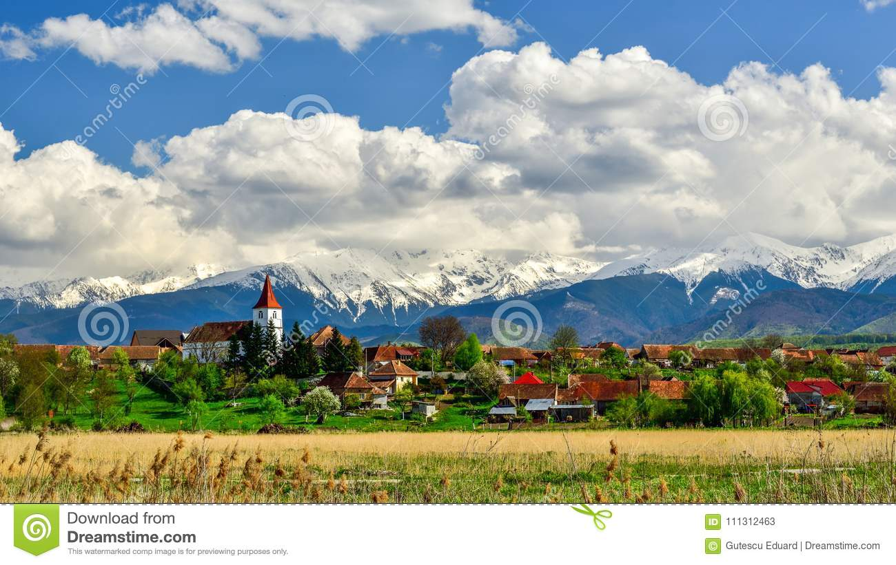 Transylvania village in Romania, in the spring with mountains in the background
