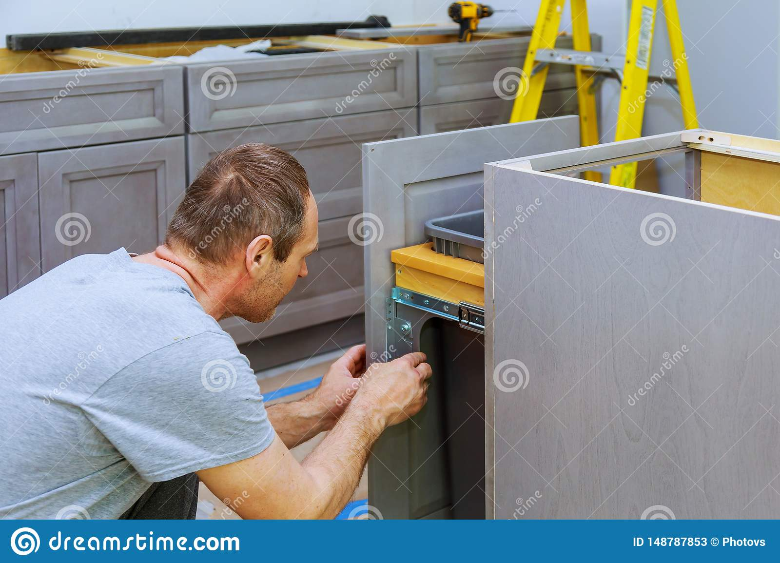 A Carpenter Is Building A Drawers Garbage Bin In The Kitchen