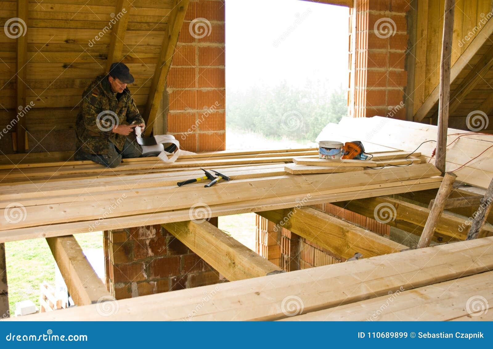 Carpenter building new floor of a loft room