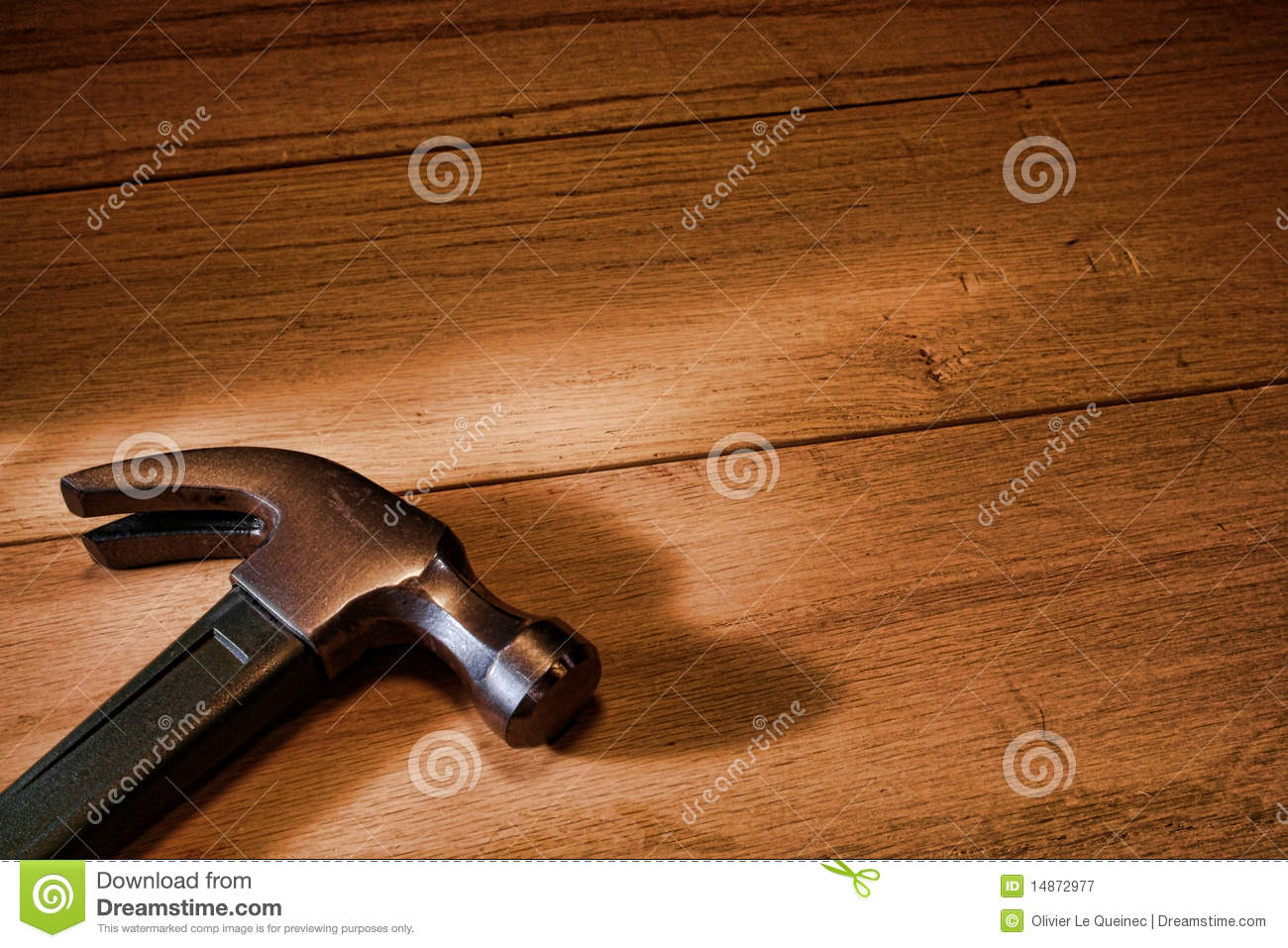 Carpenter Claw Hammer Tool on Oak Wood Boards