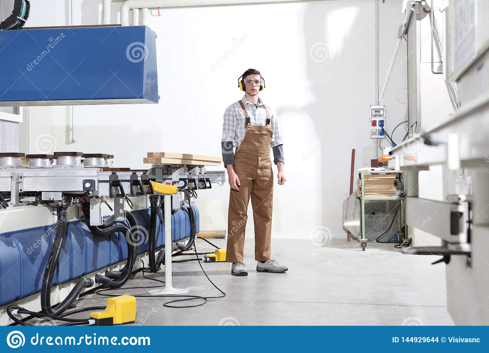 Carpenter man works with wooden planks in the joinery, with computer numerical control center, cnc machine,  isolated on a white