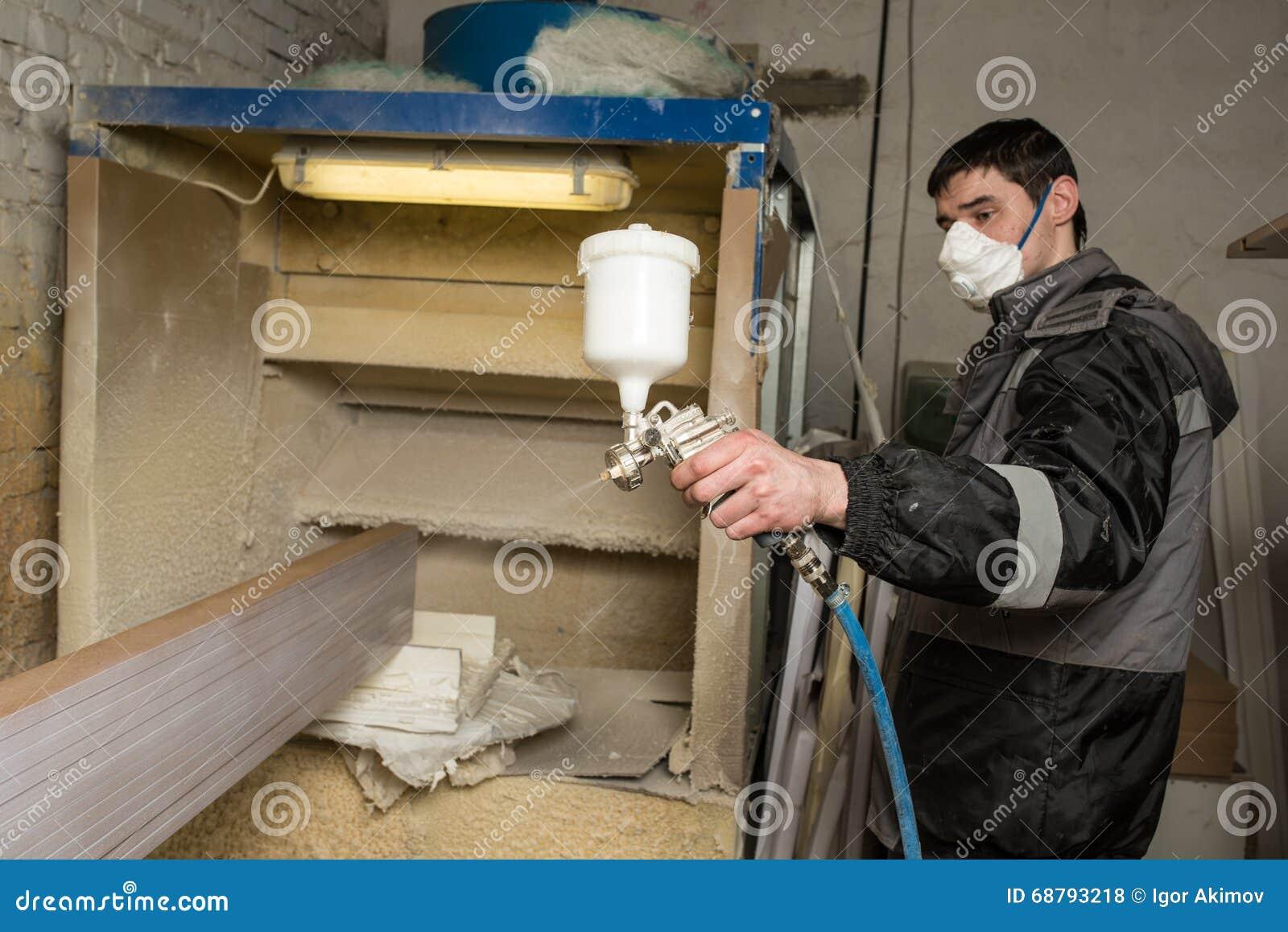 editorial stock photo download carpenter painter paints the furniture - Furniture Painter